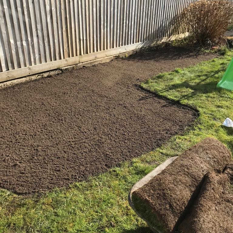 Filling in an old flower bed with soil