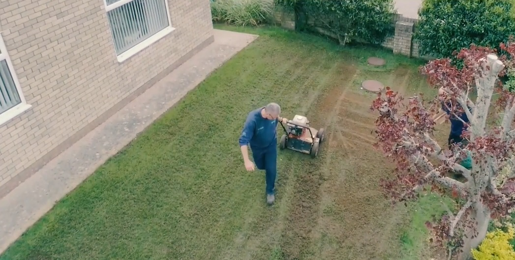 Lawn care company worker